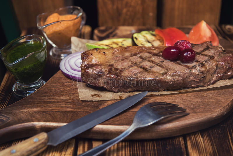 Grilled beef steak. With sauce and vegetables stock photo