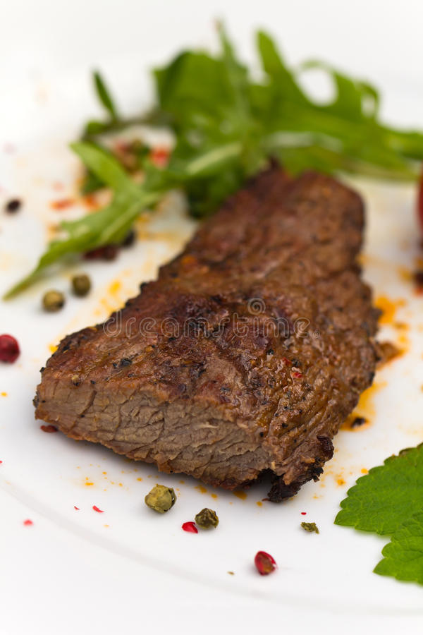 Grilled Beef Steak with spices royalty free stock photography