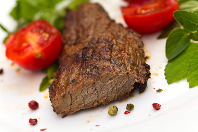 Grilled Beef Steak with spices stock photography