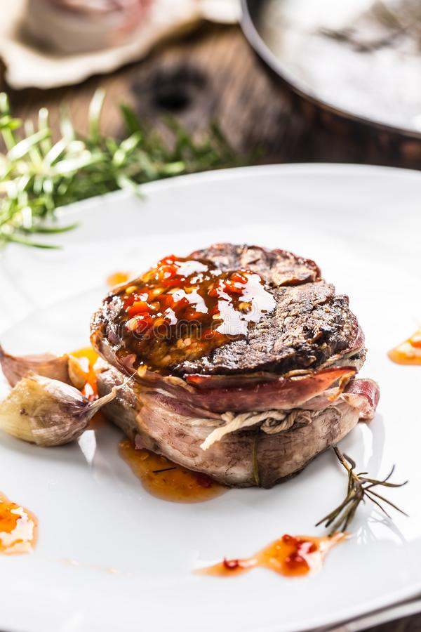 Grilled beef tenderloin steak with chili sauce in white plate.  stock photography