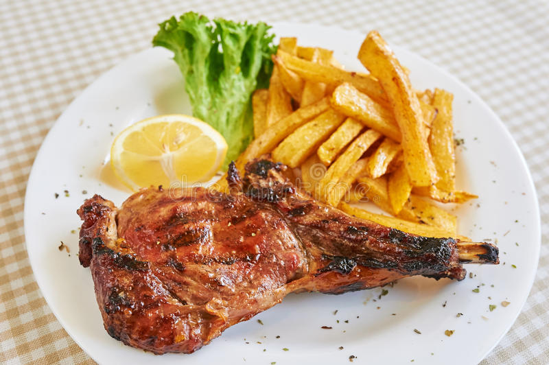 Grilled beefsteak. With french fries stock photos