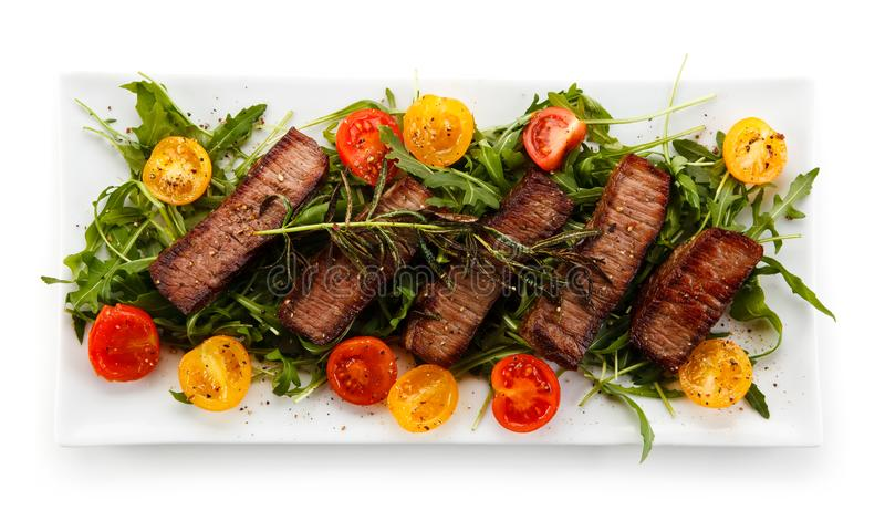 Grilled beefsteak with vegetables. On white background stock photos