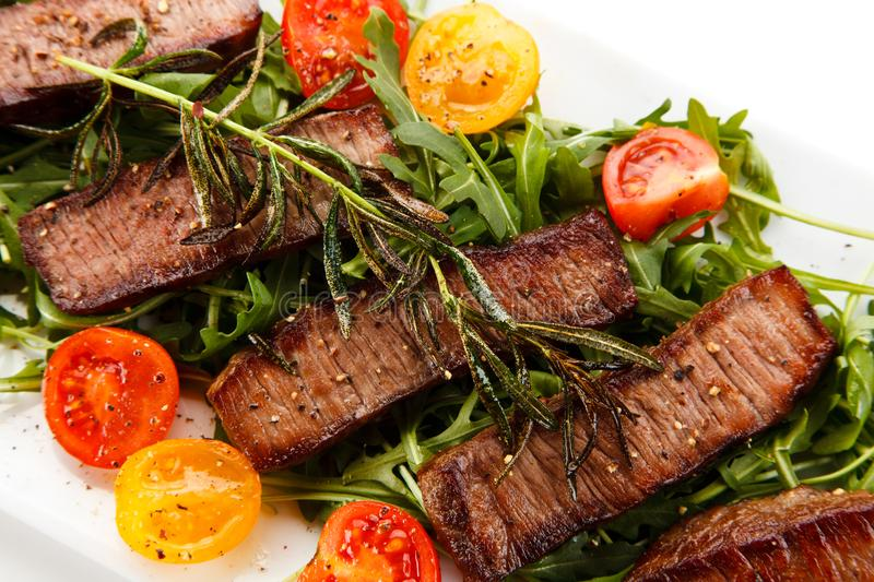 Grilled beefsteak with vegetables. On white background stock image