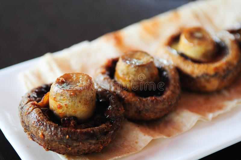 Grilled big mushrooms. Grilled big mushrooms on a Restaurant of Yerevan. Delicious food stock photography