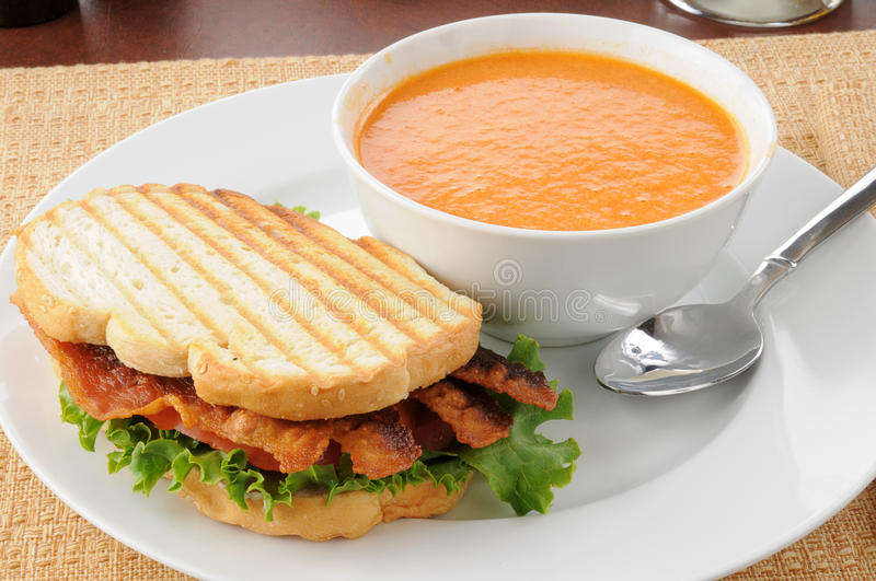 Grilled BLT with tomato bisque stock image