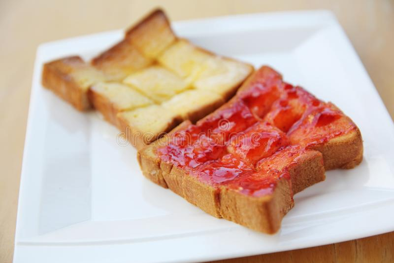 Grilled bread with starwberry jam and milk royalty free stock photography