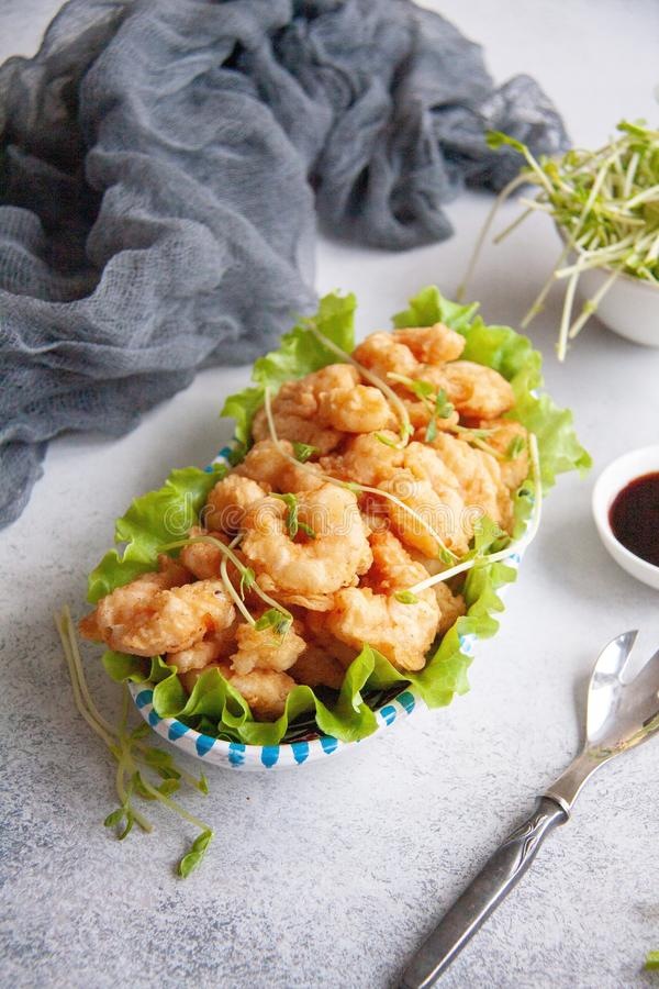 Breaded shrimp. Grilled breaded king prawns on a fresh green salad leaf stock photography