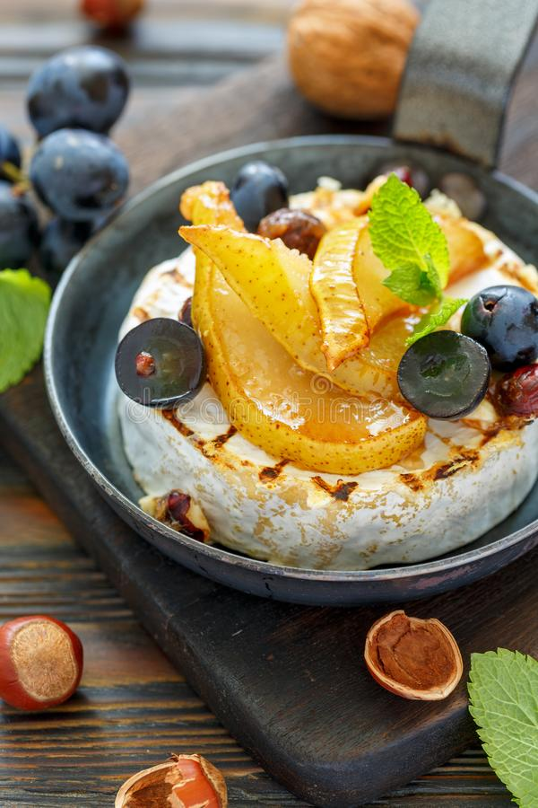 Grilled cheese with pear and black grapes closeup. stock photography