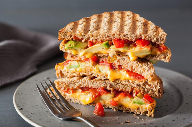 Grilled cheese sandwich with avocado and tomato royalty free stock image