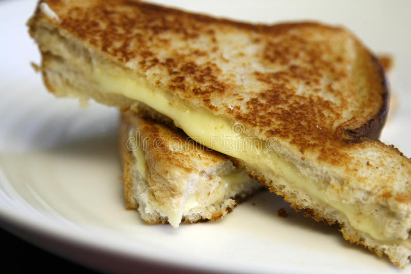 Grilled Cheese On White Plate Royalty Free Stock Images