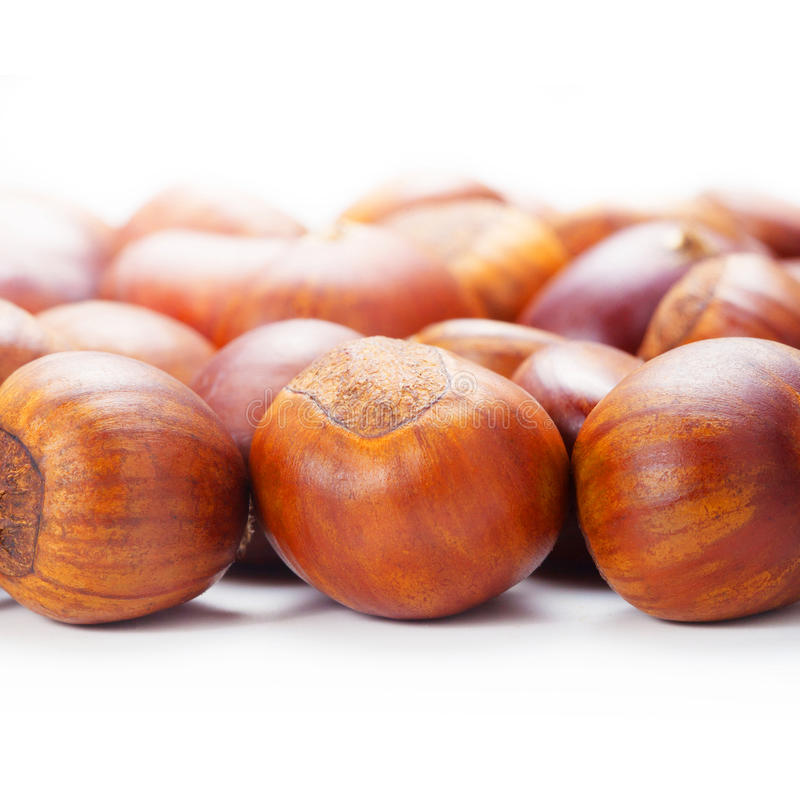 Grilled chestnuts. Isolate on white background. royalty free stock photography