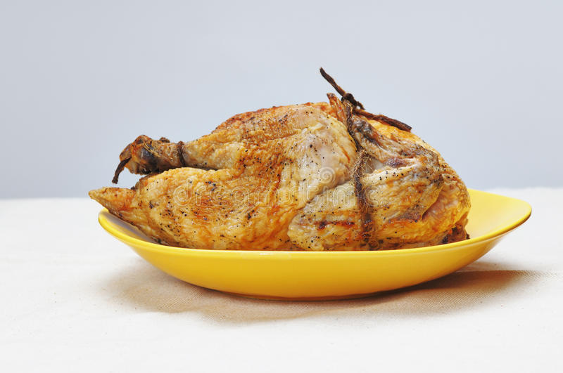Grilled chicken. Grilled chicken on the yellow plate royalty free stock image