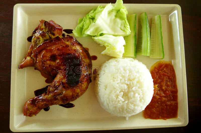 Grilled chicken Asian Food & raw salad. Chicken Lalapan - A photograph showing the very popular Indonesian and Malaysian dish of Chicken Lalapan or Ayam Lalapan royalty free stock image