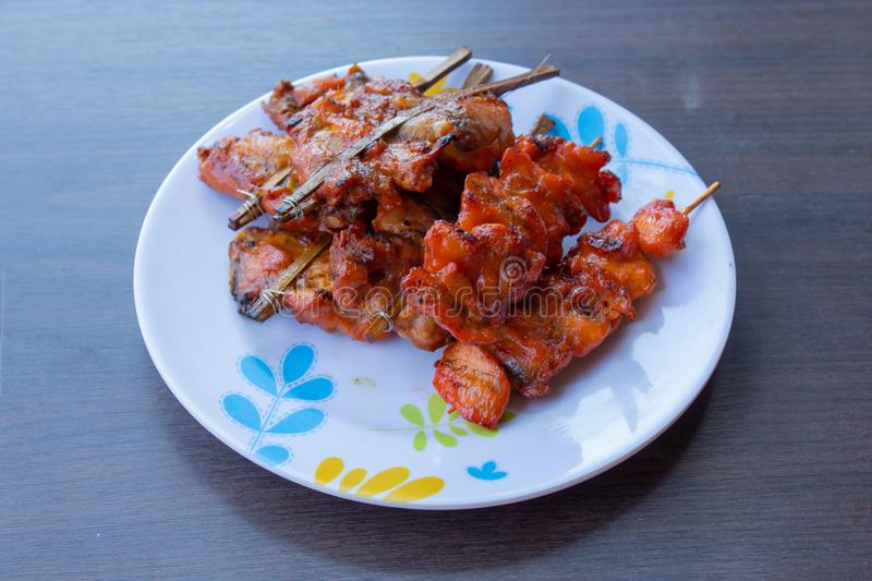Grilled chicken in bamboo stock image