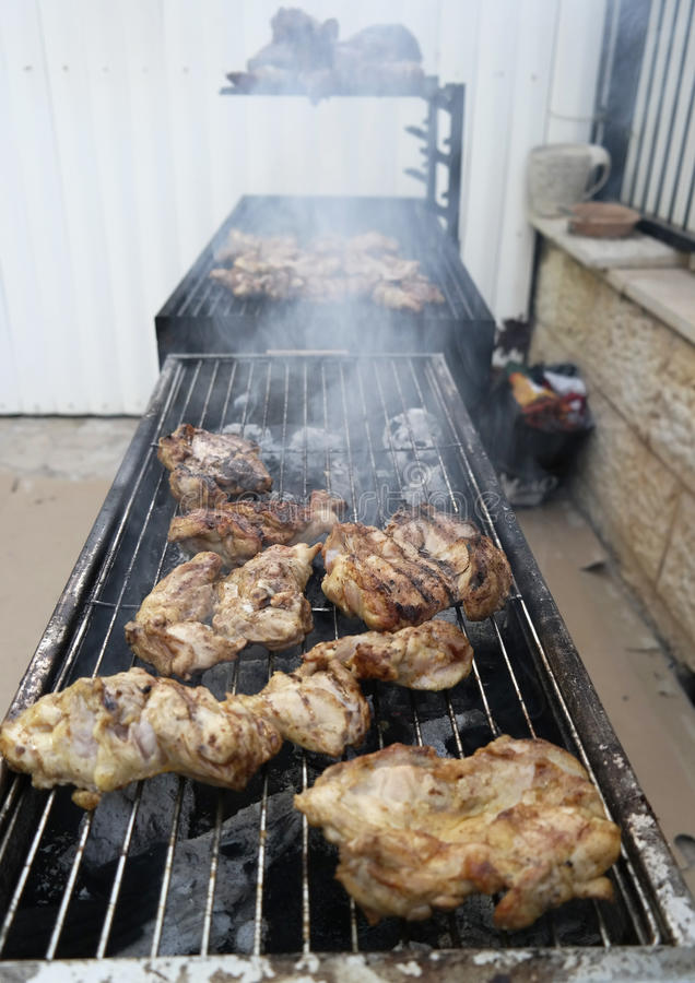 Grilled chicken barbecue. Grilled chicken pullet prepared on barbecue grill stock photos