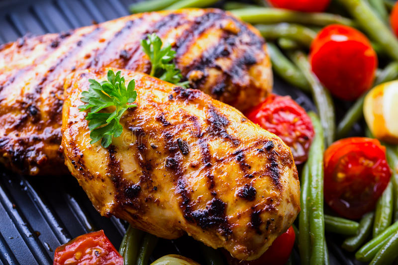 Grilled chicken breast in different variations with cherry tomat royalty free stock image