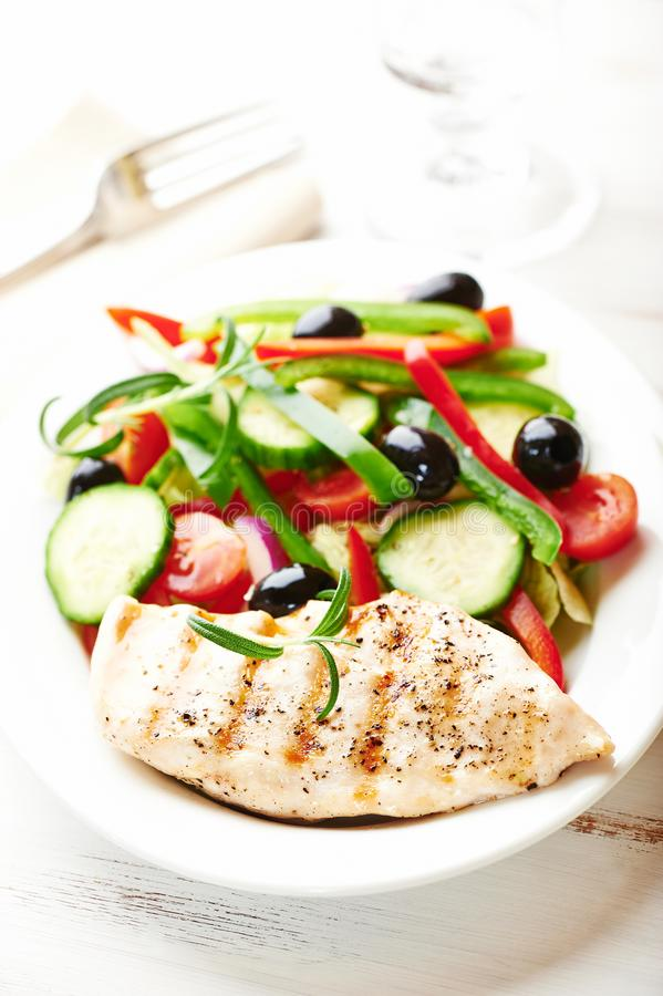 Grilled chicken breast with fresh vegetables royalty free stock photo