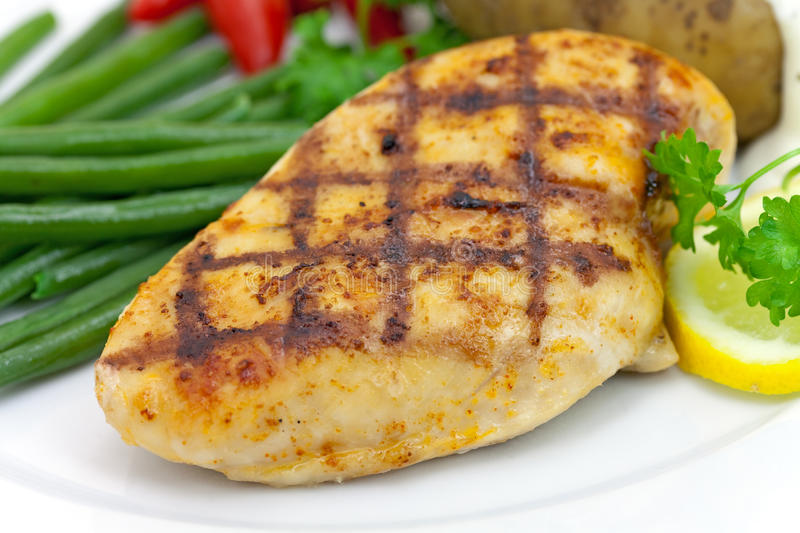 Grilled chicken breast with green beans,baked pota royalty free stock photos