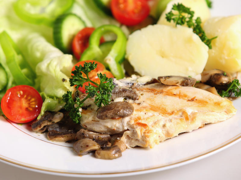 Grilled chicken breast meal royalty free stock photo