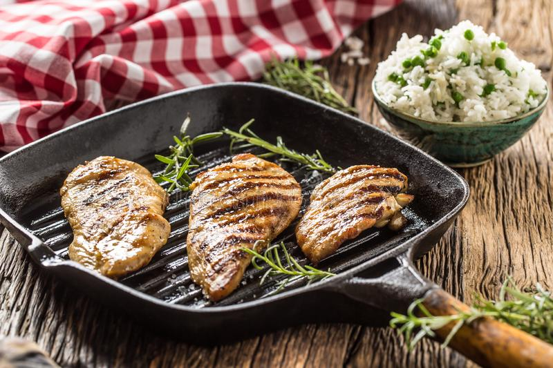 Grilled chicken breast on grilled pan with rice and green peas royalty free stock photos