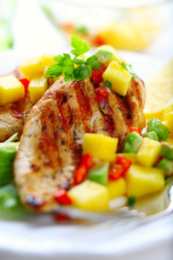 Free Grilled Chicken Breast With Fresh Mango Salsa Royalty Free Stock Photography - 17134317
