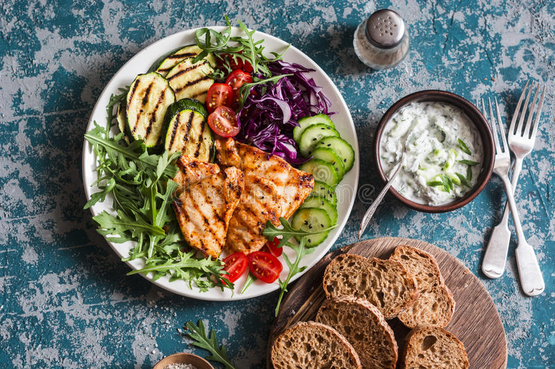 Grilled chicken breast, zucchini and garden vegetable power bowl. Healthy diet food concept. Top view royalty free stock photos