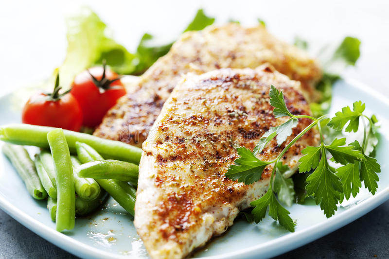 Grilled chicken brest fillet royalty free stock photos