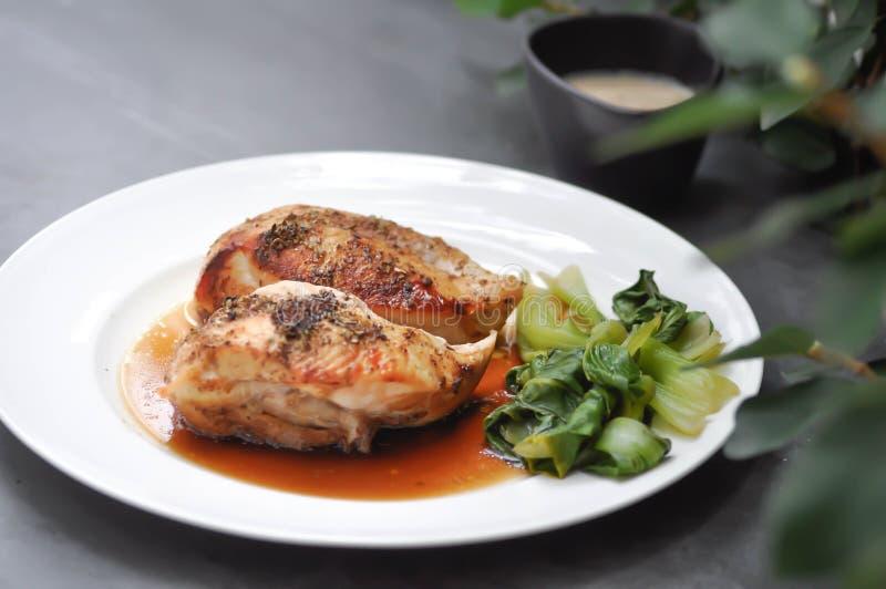 Grilled chicken or chicken steak stock photography