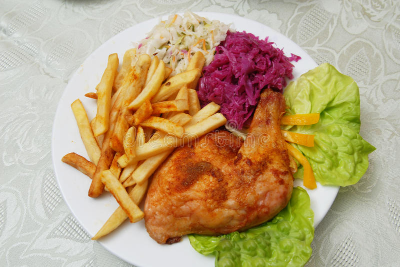 Grilled chicken and chips royalty free stock photo