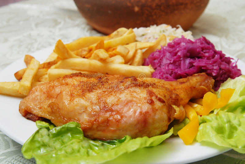 Grilled chicken and chips stock photos