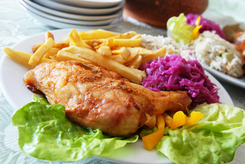 Grilled chicken and chips stock photography