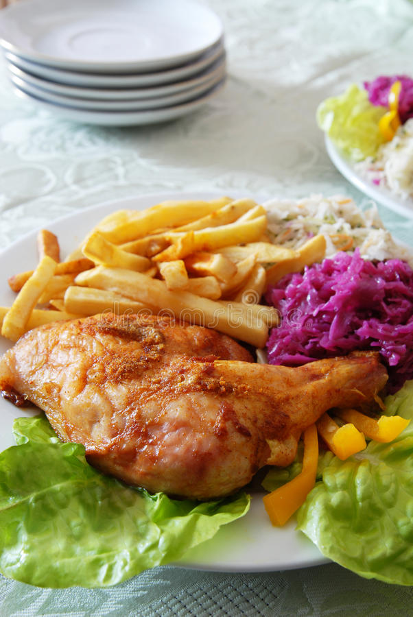 Grilled chicken and chips stock photo