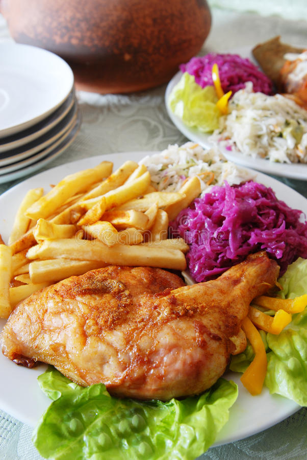 Grilled chicken and chips royalty free stock images