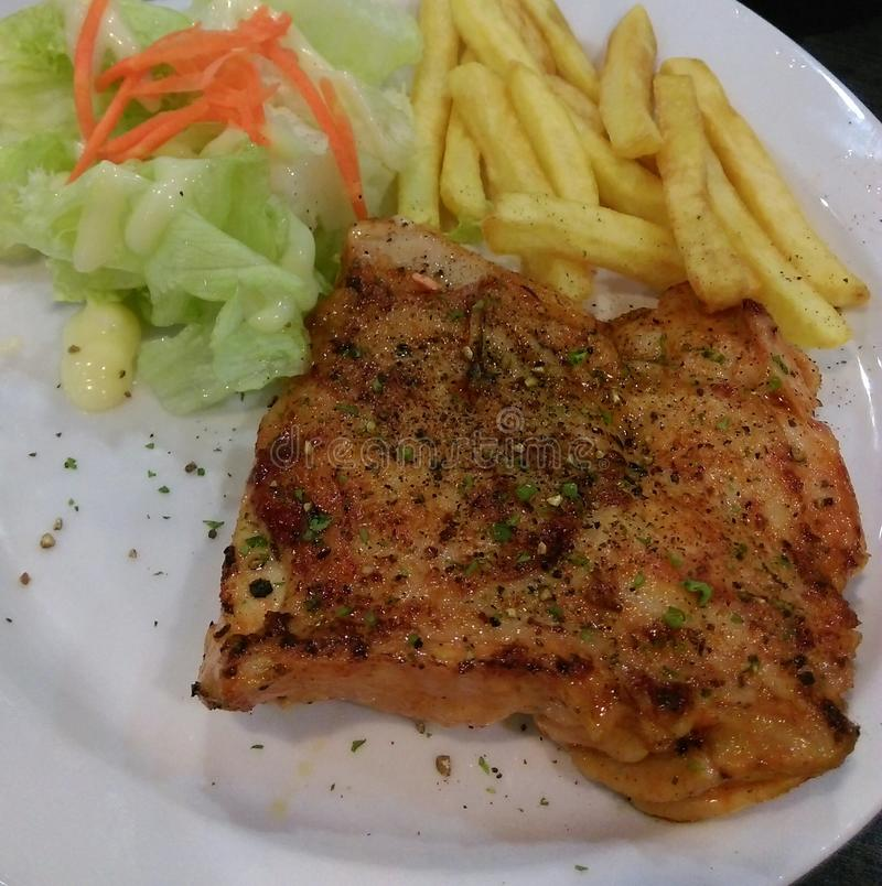 Grilled chicken with salad and chips stock image