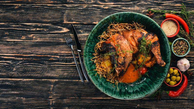 Grilled chicken cooked in a hoster. Meat. Top view. On a black wooden background. Copy space stock photo