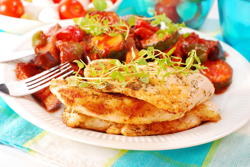 Grilled chicken fillet and ratatouille. Dinner with grilled chicken fillet and ratatouille stock photo