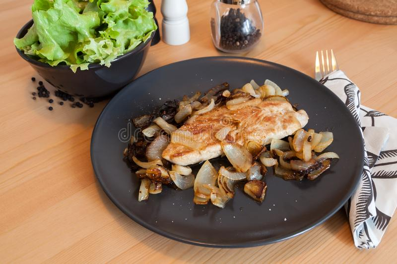 Grilled chicken with green salad. Shot of grilled chicken with green salad royalty free stock images