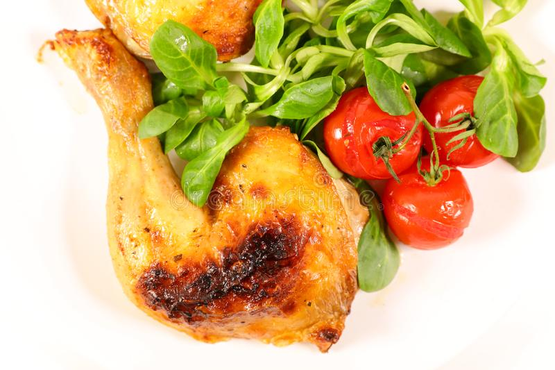 Grilled chicken leg. And salad royalty free stock image