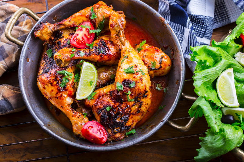 Grilled chicken legs, lettuce and cherry tomatoes limet olives. Traditional cuisine. Mediterranean cuisine stock photo