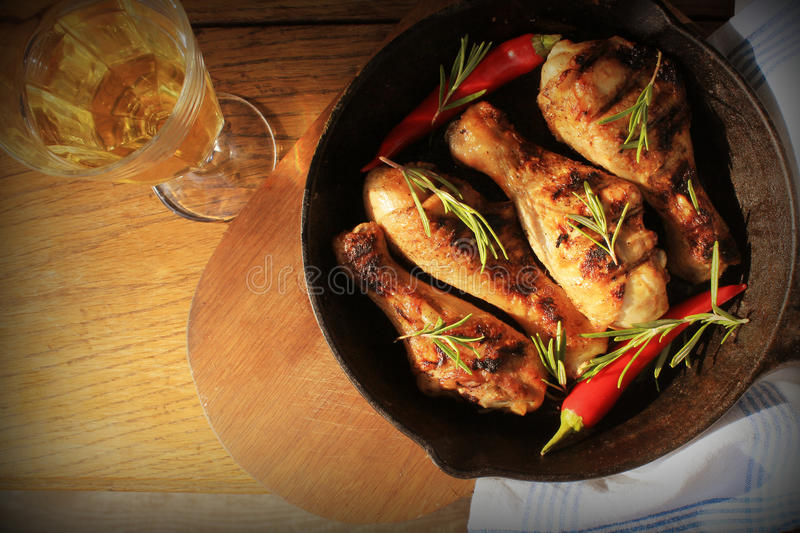 Grilled chicken legs on pan . Top viw. royalty free stock image