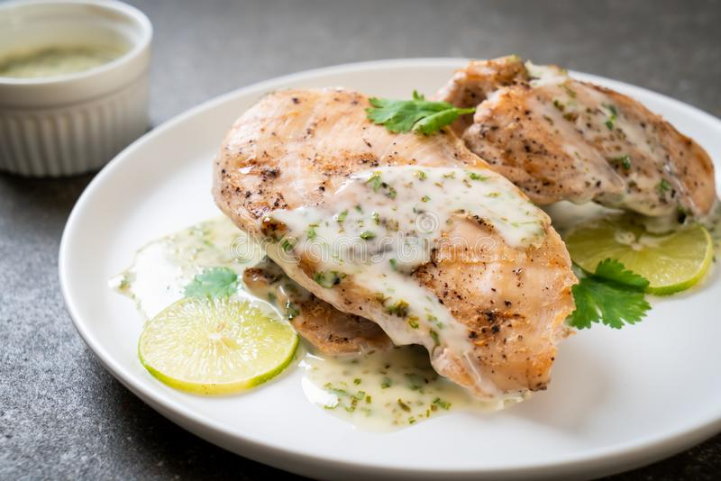 Grilled chicken with lemon lime sauce. Grilled chicken breast with lemon lime sauce royalty free stock image