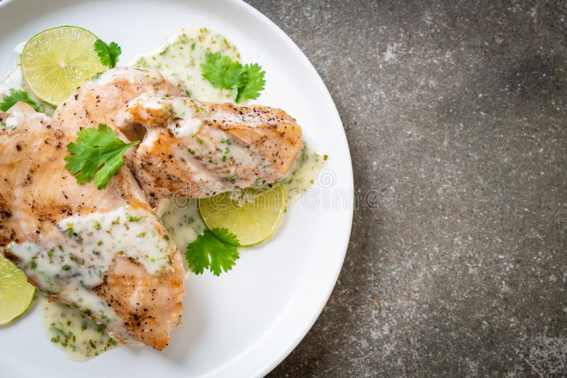Grilled chicken with lemon lime sauce. Grilled chicken breast with lemon lime sauce royalty free stock photography