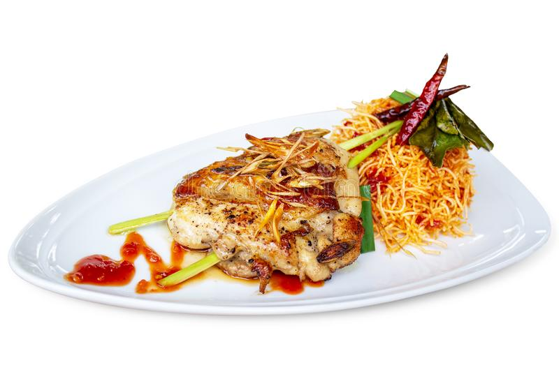 Grilled Chicken Lemongrass with Crispy Fried Noodle and Tamarind sauce stock images