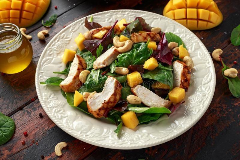 Grilled Chicken Mango salad with nuts and vegetables. Healthy food. Grilled Chicken Mango salad with nuts and vegetables. Healthy food stock image