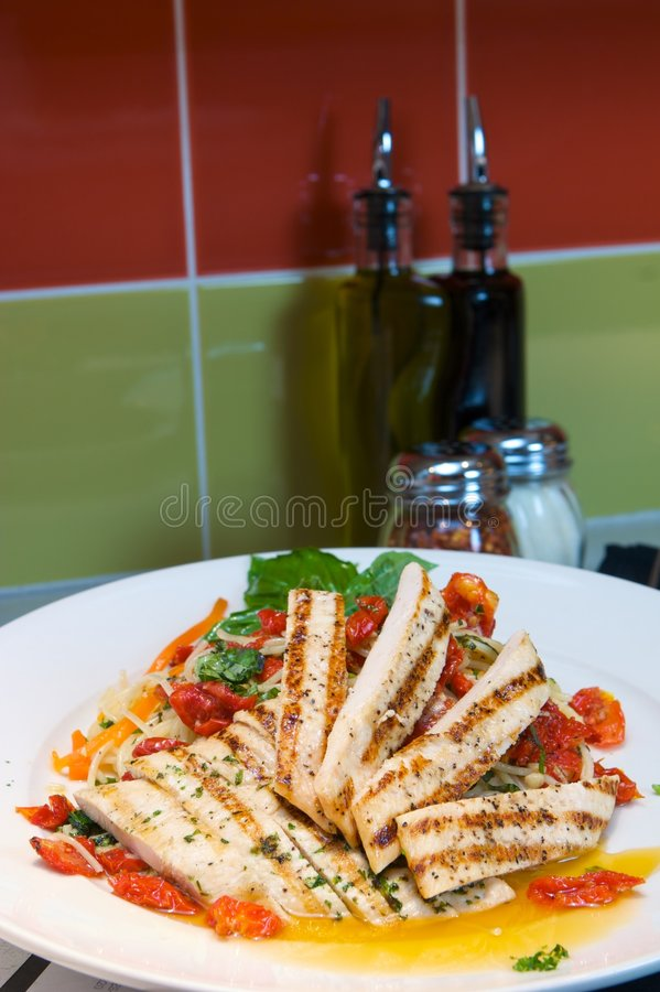Grilled chicken over Italian pasta stock photography