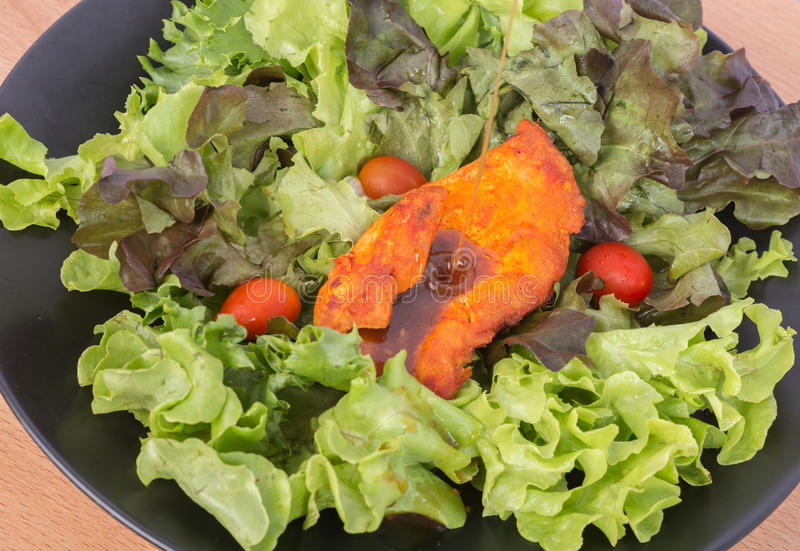 Grilled chicken paprika pepper with vegetable salad none oil low fat diet healthy stock images