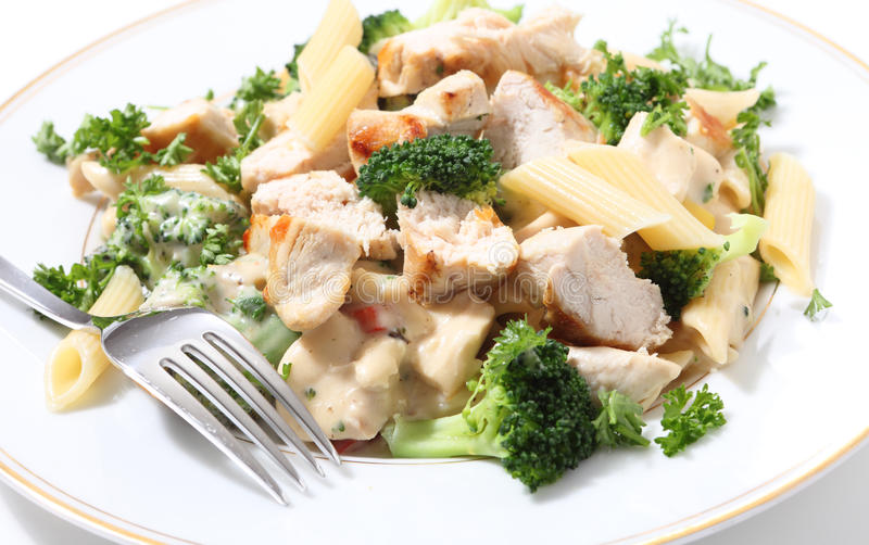 Grilled chicken with pasta and fork royalty free stock image