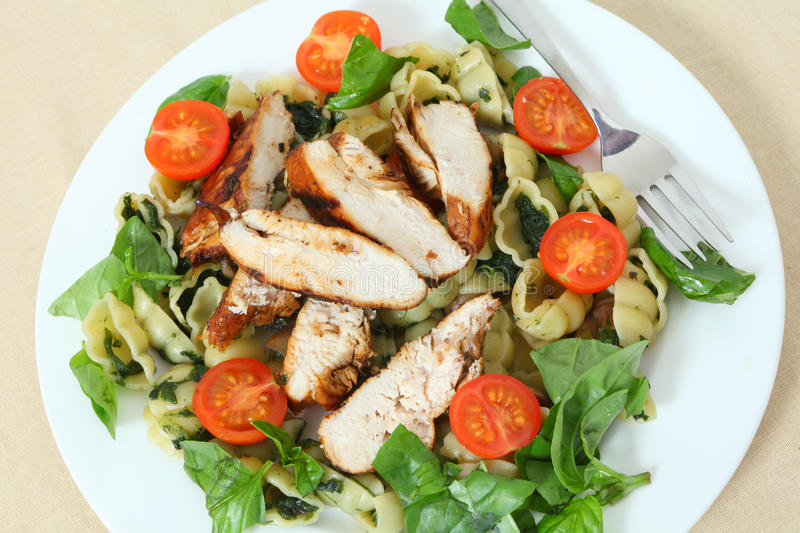 Grilled chicken and pasta salad high angle stock image