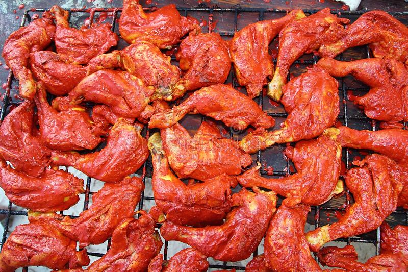 Grilled chicken in red achiote sauce royalty free stock images