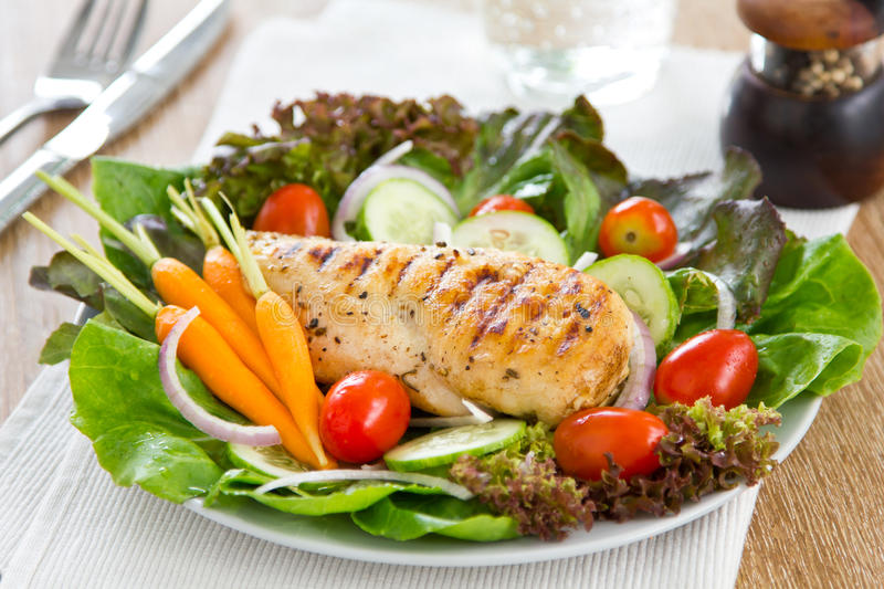 Grilled chicken and salad stock photography